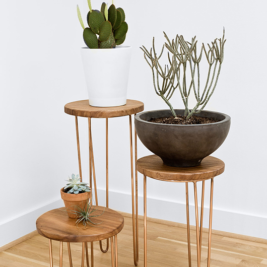 wood and copper tables from the citizenry with potted succulants / sfgirlbybay