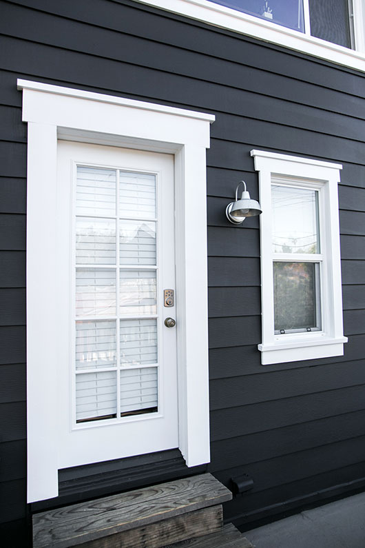 black and white benjamin moore exterior paint and industrial sconce