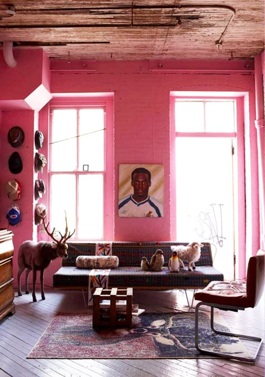 hot pink painted brick wall in eclectic living room. / sfgirlbybay