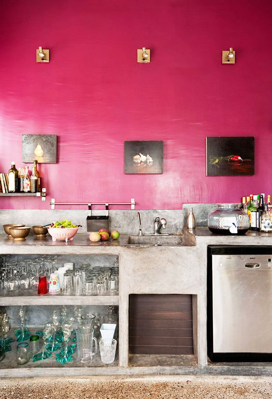 magenta kitchen walls above concrete countertops and shelves / sfgirlbybay