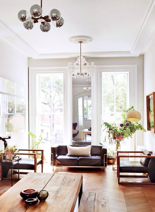 modern living room with tall white ceilings and pendant light fixture with silver bulbs / sfgirlbybay