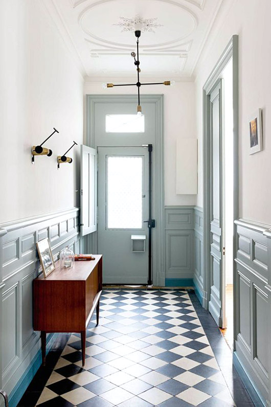 entry way with mint details and black and white patterned floor tiles / sfgirlbybay