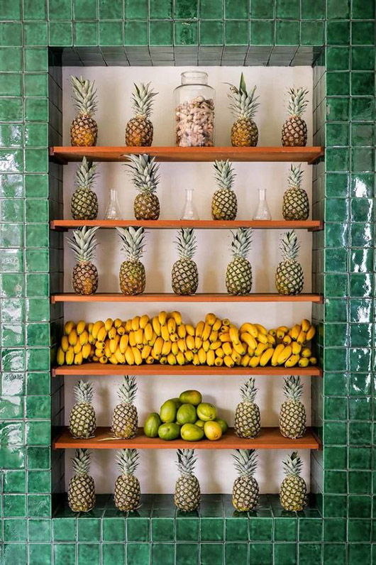 emerald green tile and fruit displayed at the cold pressed juicery in amsterdam / sfgirlbybay