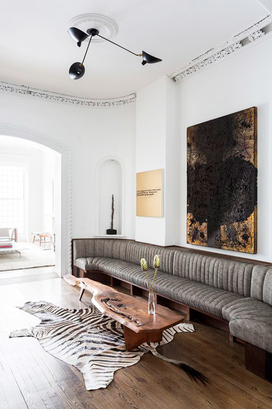 large painting over gray tufted sectional sofa / sfgirlbybay