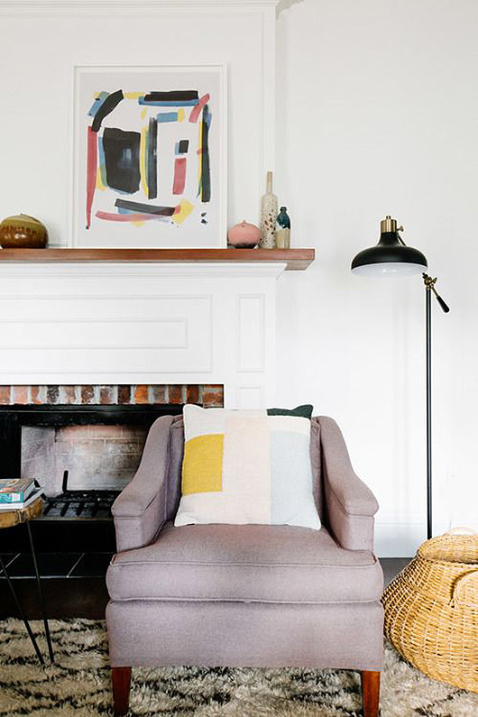colorful abstract art leaning on mantel / sfgirlbybay