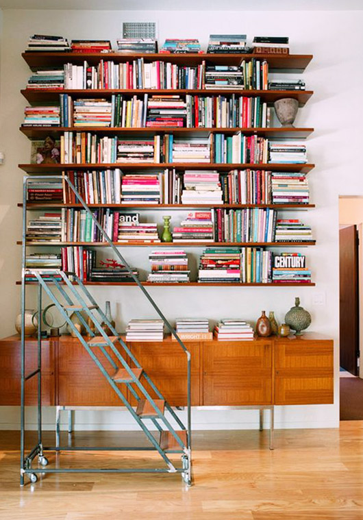 open wood shelves with books and rolling vintage library cart / sfgirlbybay