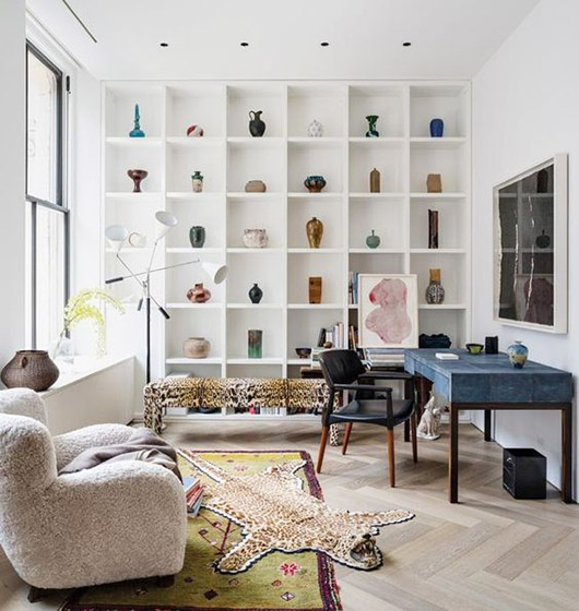 wall with whilte built-in bookcase displaying a colorful vase collection / sfgirlbybay