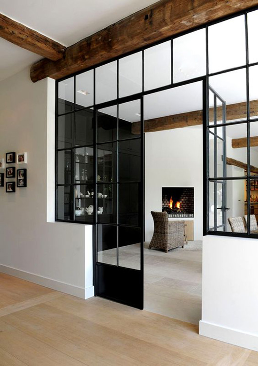 exposed wood beams and black framed window casings. / sfgirlbybay