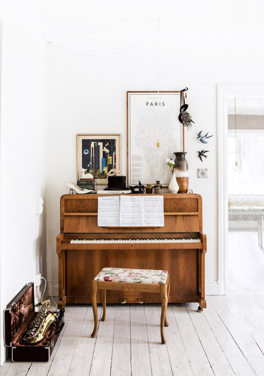 small vintage piano with vintage decor on top / sfgirlbybay