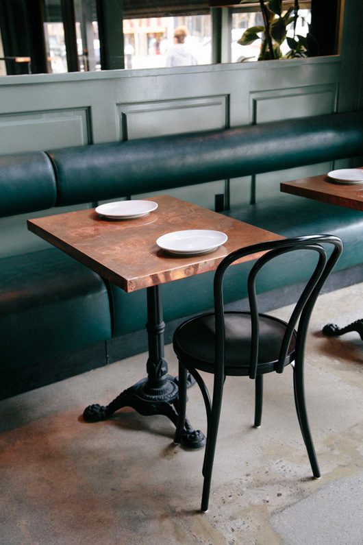 banquette and tables with chairs at cafe birdie. / sfgirlbybay