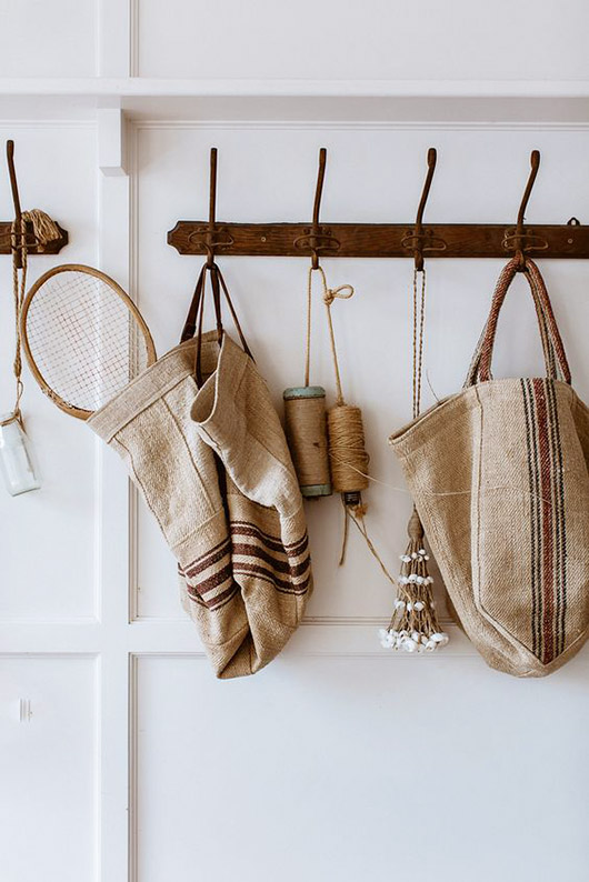hallway hooks with woven bags and accessories. / sfgirlbybay