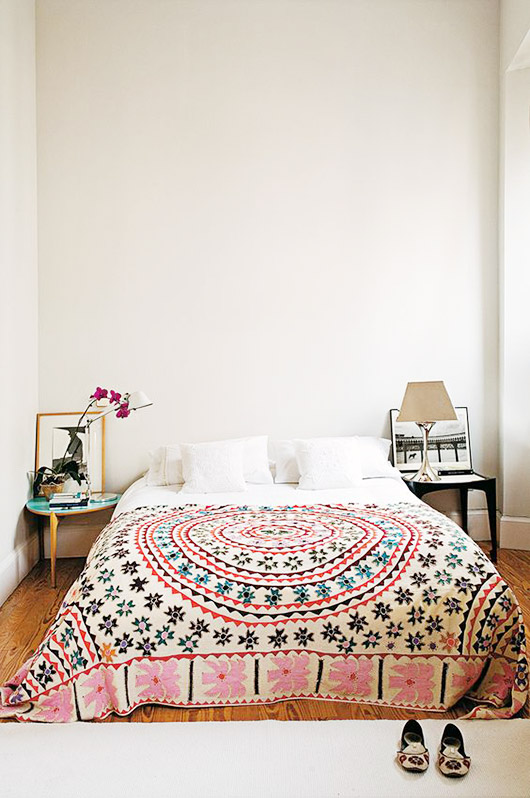 moroccan quilt on white bed linens. / sfgirlbybay