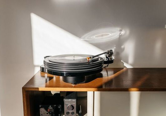 light reflecting off record player. / sfgirlbybay