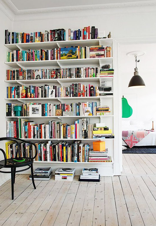 tall white book shelves. / sfgirlbybay